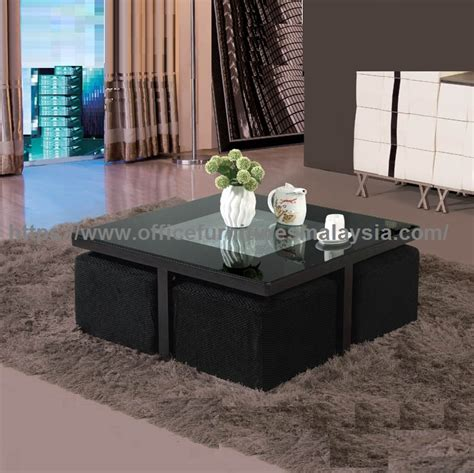 square coffee table with black sofa stools underneath