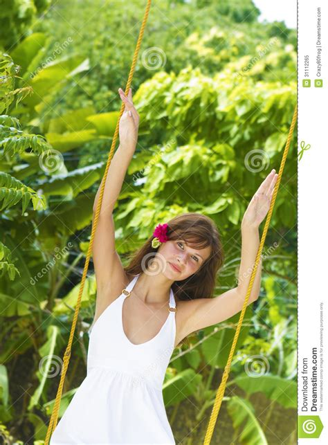 Young Beautiful Woman Swinging Royalty Free Stock Photo