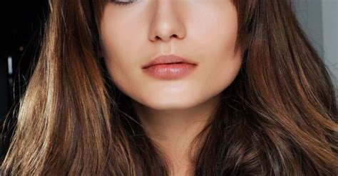 haircuts that compliment cheek bones a full fringe can easily shape your face and enhance your