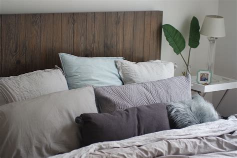 bed full of pillows grey and silver linen bed with too many pillows leo with