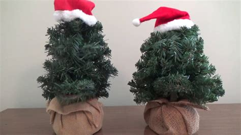 douglas fir the talking tree gemmy animated douglas fir quot the talking tree quot burlap bag both versions