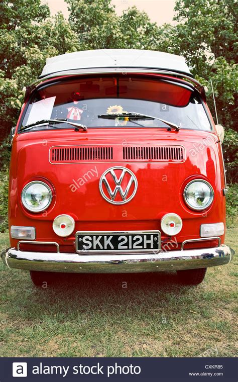 volkswagen van front view front view of red vintage vw cer van parked on grass