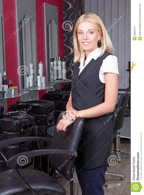 Professional Hair Dresser by Portrait Of Professional Hairdresser In Salon Stock