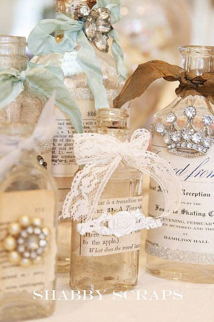 take antique bottles and decorate them with ribbons and