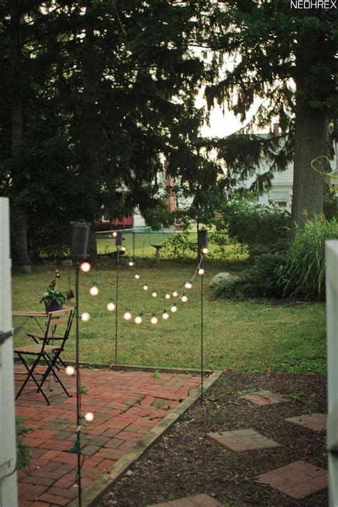 Tiki torches and solar lights border patio area. Simple