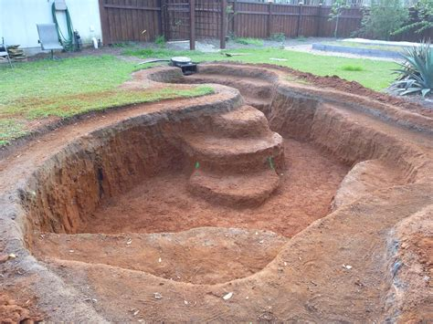 digging a backyard pond part 4 pond construction waterfall formed pond digging