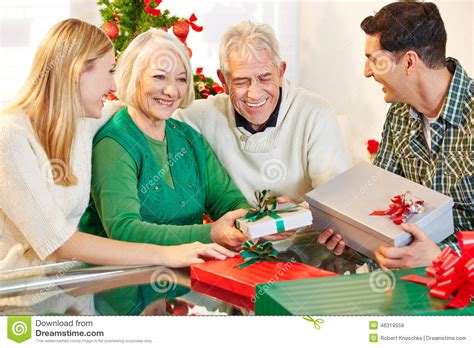 senior citizens celebrating christmas with their children