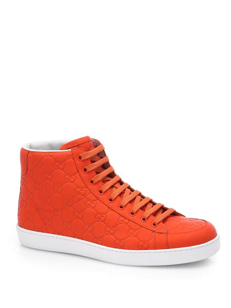 orange sneakers gucci rubberized leather gg hightop sneakers in orange for