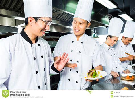 cook s asian chef in restaurant kitchen cooking royalty free stock photography image 38145767