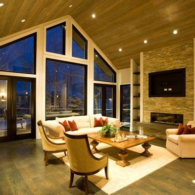 vaulted ceiling with fireplace for the home