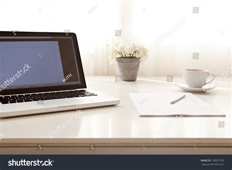 up view of a work desk interior with a laptop