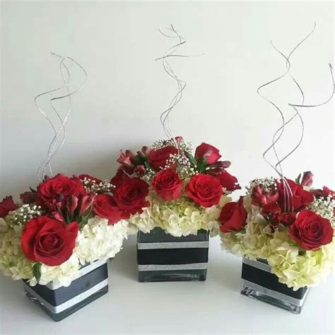white hydrangea base and red roses with silver accents