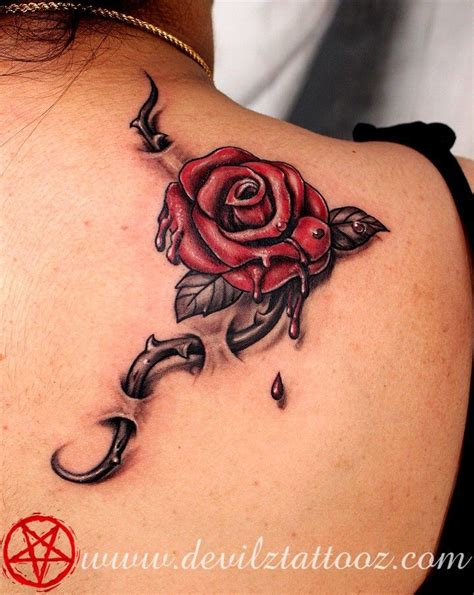 rose thorn tattoo meaning through skin tattoos spine