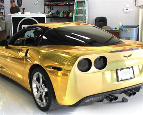 rose gold corvette gold chrome wrap on a corvette by zilla wraps metallic
