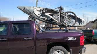 kayak bicycle on thule rack on diamondback truck cover o