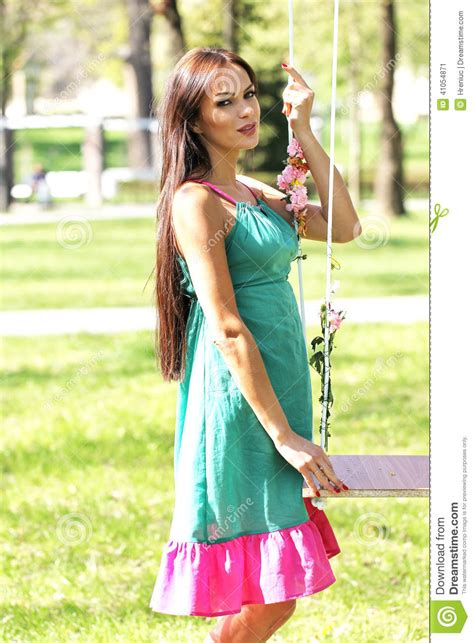 lady swings pink purple green dress lady on a swing stock image
