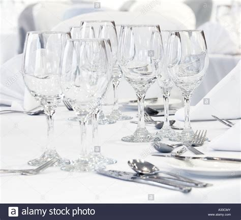 Glasses Table Setting Wine Glasses On A White Tablecloth With Place Table Settings Stock Photo Royalty Free Image