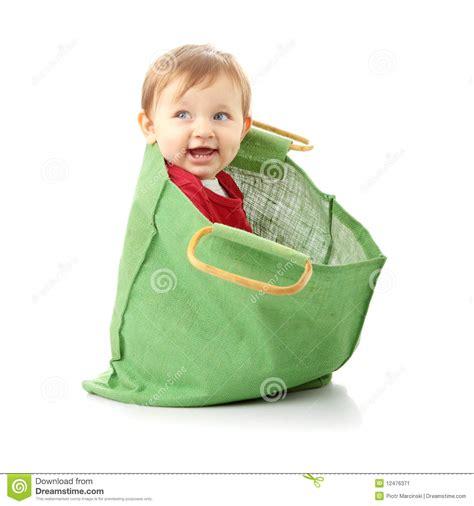 baby shopping baby in shopping bag stock image image 12476371