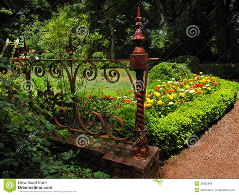 Garden Of Iron Flower Garden With Antique Wrought Iron Gate Stock Image