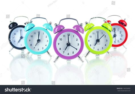 Colorful Clock Green colorful alarm clock isolated on white stock photo