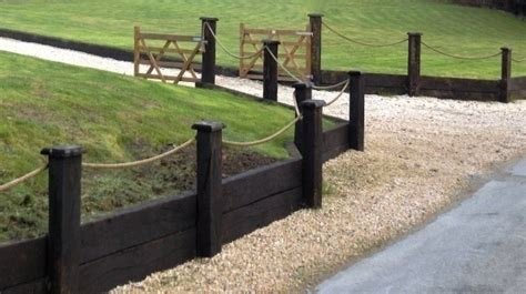 Railway Sleepers Fence by Fencing Hennessey Timber