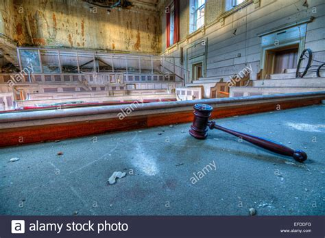 judge on the bench gavel lying on the judge s bench inside the derelict crumlin road stock photo royalty