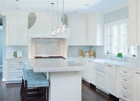 blue tile kitchen backsplash white quartz countertops stainless steel oven and