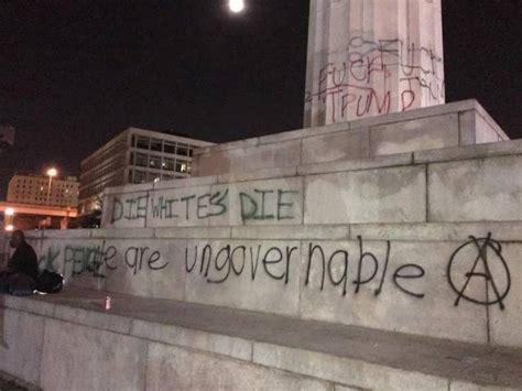 die whites die rioters spray paint hate  monument