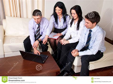people having on the couch happy business people on couch royalty free stock images