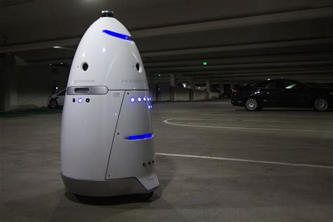 Parking Lot Robot welcome to the future beats up security robot