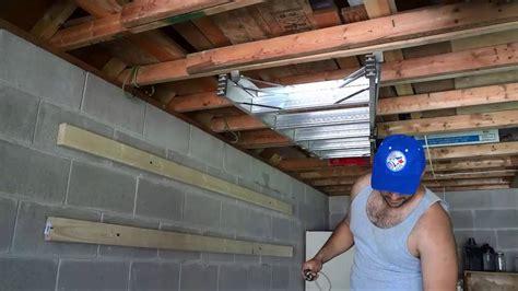 ceiling ladder storage diy ladder storage with bungee cords garage organization