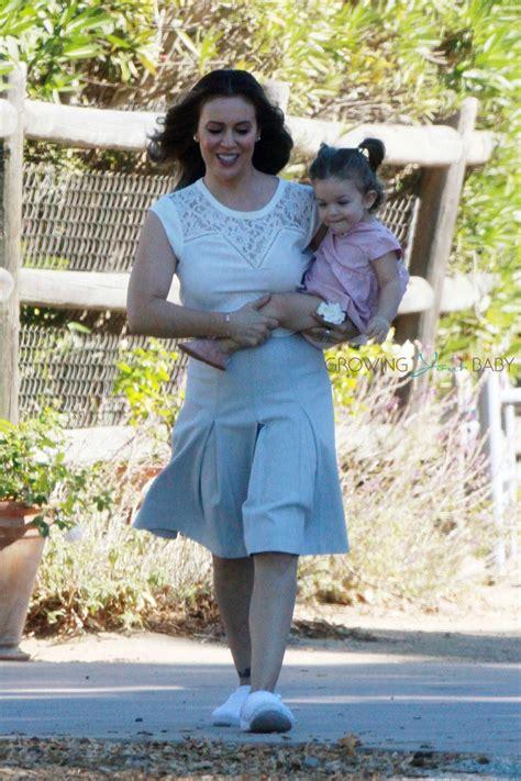 alyssa milano carries daughter elizabella   set