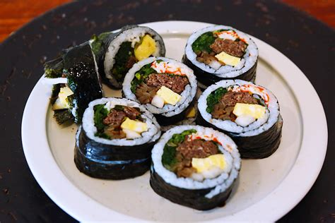 this korean sushi is stuffed with surf n turf munchies