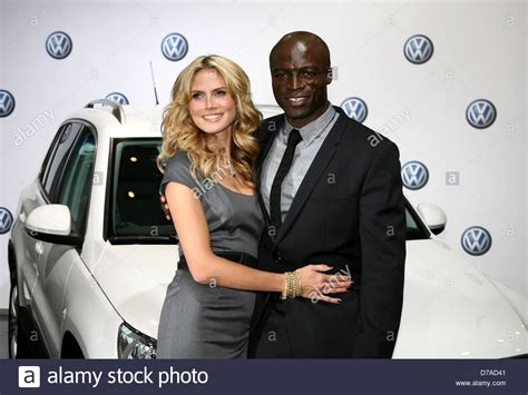 Heidi Klum And Seal In Germany Promoting Volkswagen Get Heidis Look by Heidi Klum L And Seal R Pose During The Presentation