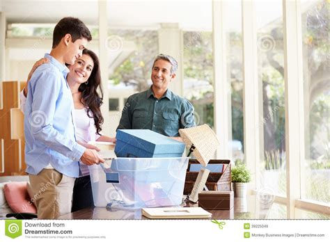 parents helping pack for college stock image