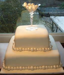 Pearls 2 tier fondant covered wedding cake with champagne glass