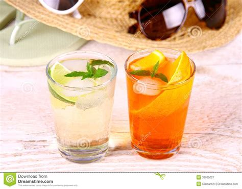 holiday cocktails background mojito and orange cocktails with holiday background