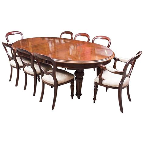 antique oval dining table and eight chairs