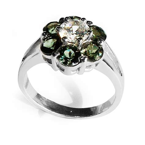 silver ring with 6 green tourmalines and central white