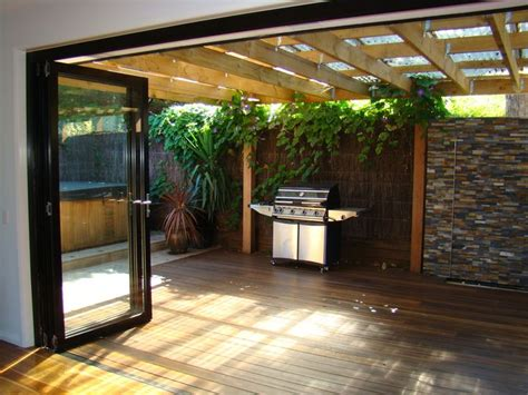 outdoor entertainment ideas sun room with bifold doors extending onto decking and