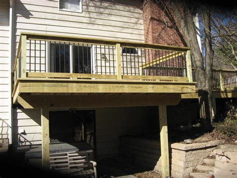 decks treated wood deck installation  missouri