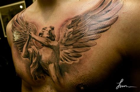 angel tattoos on chest chest writing