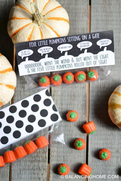 Five Pumpkins Sitting On A Gate Printable