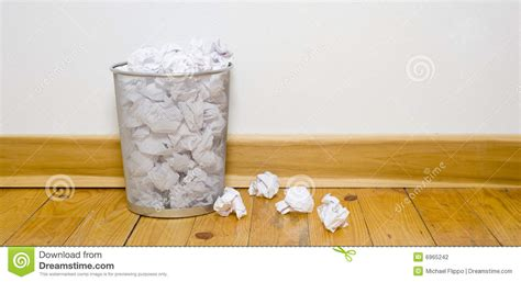 office trash   wood floor stock photo image
