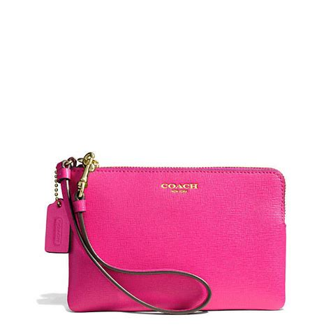 the pink clutch a small space with a big statement coach boxed small wristlet in saffiano leather where to