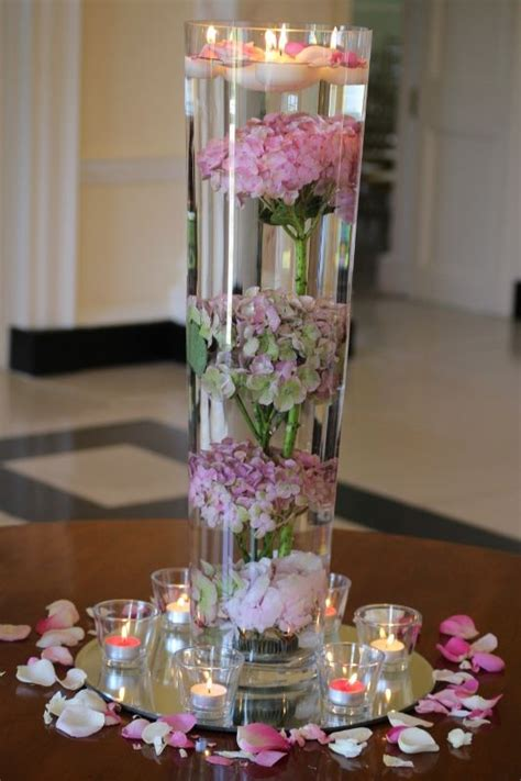 unusual floating candles tall vase centrepiece