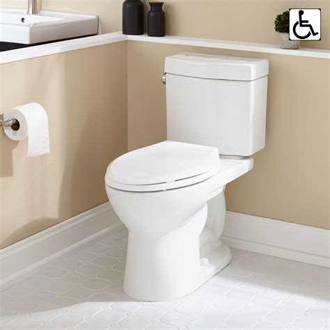 bathroom with two toilets luther two piece elongated toilet ada compliant