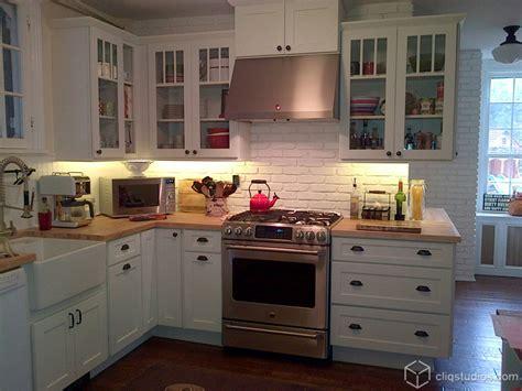 white brick backsplash Kitchen Traditional with apron sink