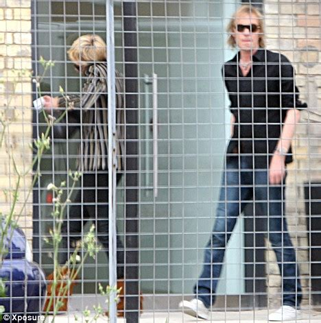 worse for wear rhys ifans cosies up to another pretty