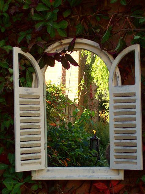 oval top  louvre doors garden mirror uk garden